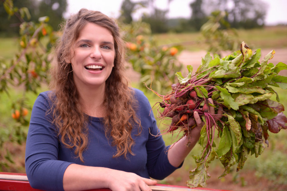 Vivian Howard of A Chef's Life holding a bunch of beets